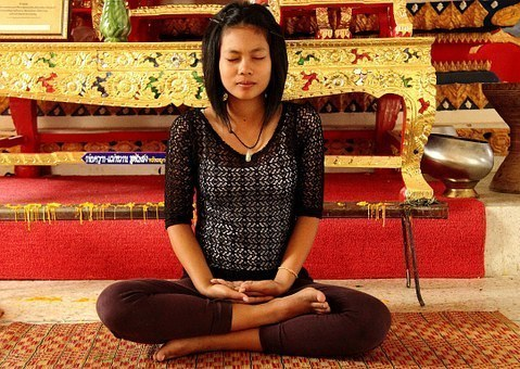 Woman meditating in a blissful pose
